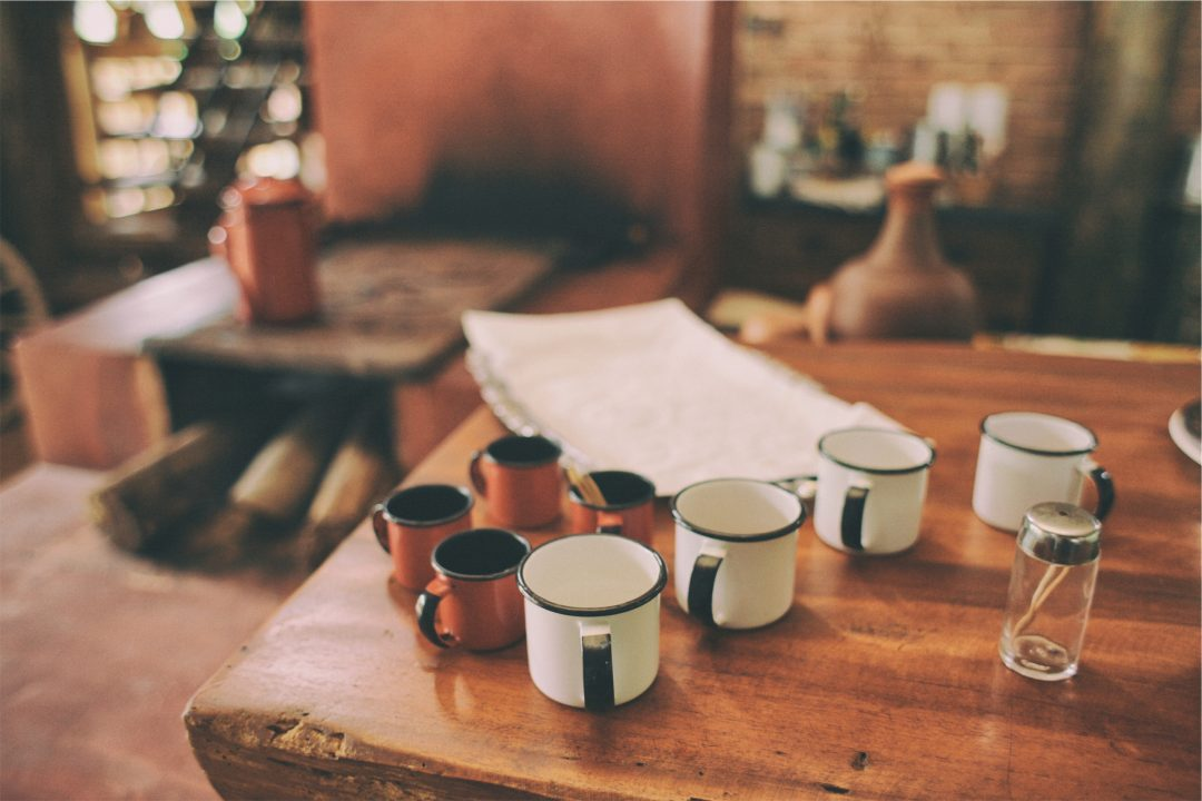 coffee cups on a table with work papers