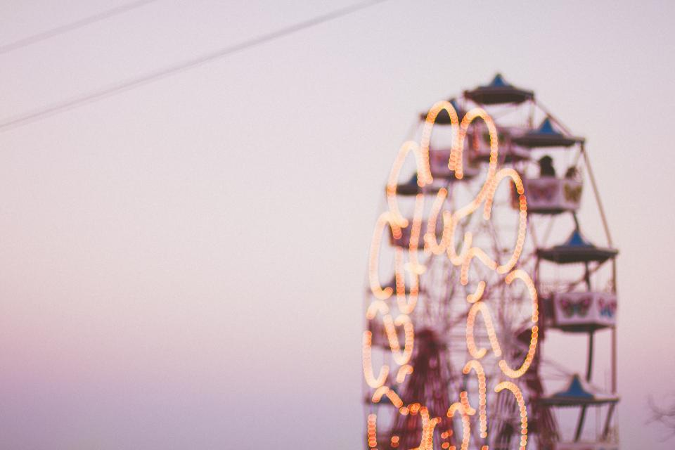 image of ferris wheel with people riding